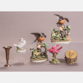 A Group Of Four Porcelain Birds Form Figures,