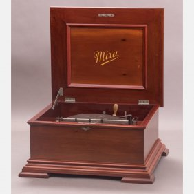 A Mira Mahogany 12 Inch Disc Music Box With Forty-one