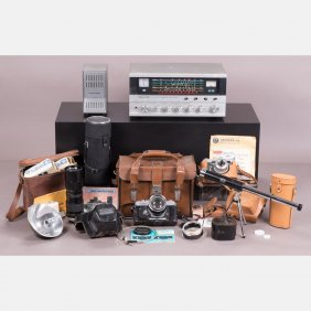 A Collection Of Vintage Camera Equipment And Stellar