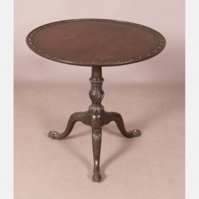 A Chippendale Heavily Carved Mahogany Tilt Top Tea