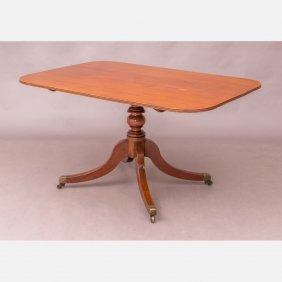 A Georgian Style Mahogany Tilt Top Dining Table, 19th