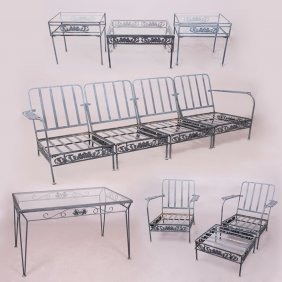 A Suite Of Patinated Metal Outdoor Furniture In The