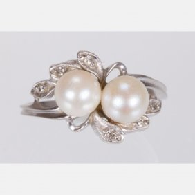 A 14kt. White Gold, Pearl And Diamond Melee Ring,