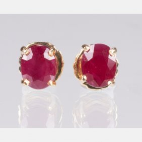 A Pair Of 14kt. Yellow Gold And Ruby Earrings,