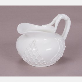 A Knowles Taylor Knowles White 'lotus Ware' Creamer,