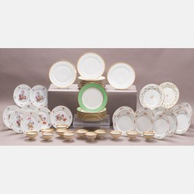 A Set Of Twelve Limoges Dinner Plates With Gilt