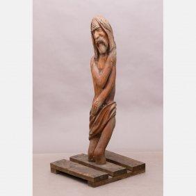 A Folk Art Carved Pine Figure Of Jesus, 20th Century.