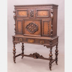 A Renaissance Revival Carved Oak And Walnut Cabinet,