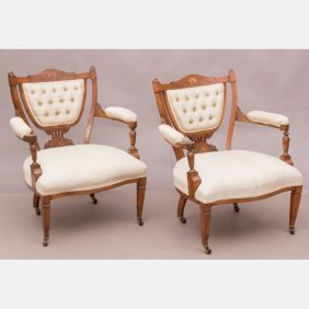 A Pair Of Italian Walnut Parlor Chairs, 19th Century.