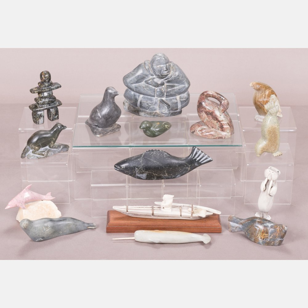A Group of Fifteen Inuit Carved Stone Sculptures by