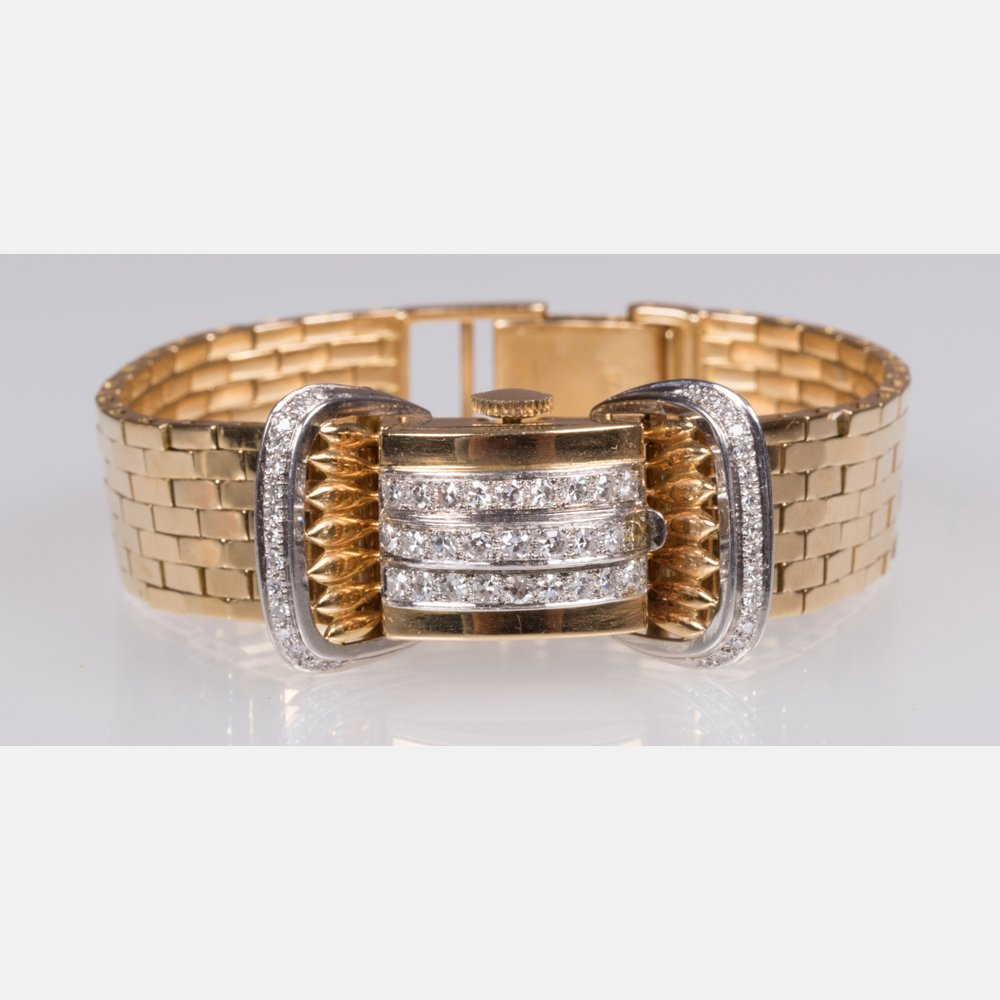 A Ladies 18kt. Yellow and White Gold and Diamond
