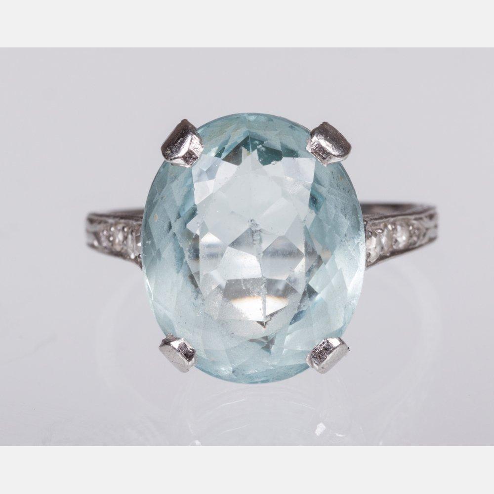 A Platinum, Aquamarine, and Diamond Ring,