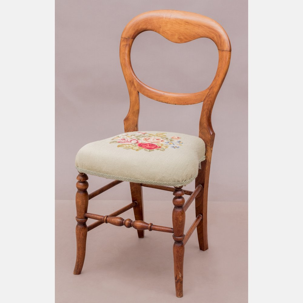 A Victorian Walnut Side Chair with Needlework Seat,