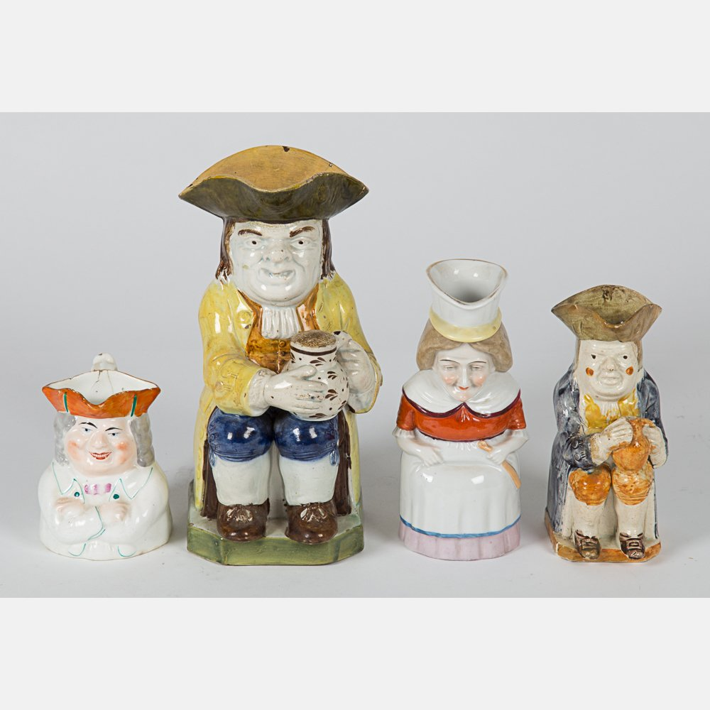 A Group of Four Staffordshire Toby Jugs, 18th/19th