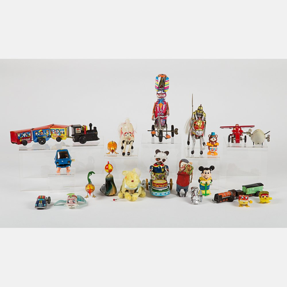 A Miscellaneous Collection of Vintage Tin Wind-Up Toys,