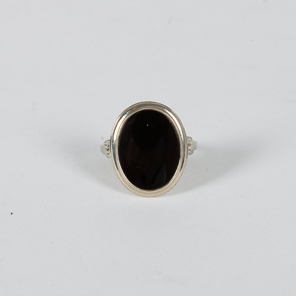 A 14kt. White Gold and Onyx Ring.