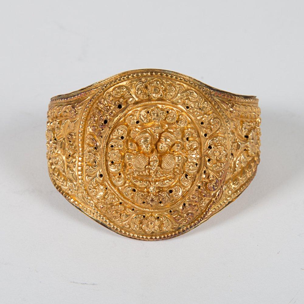 A Nepalese Newari Gold Repousse Cuff Bracelet, 19th