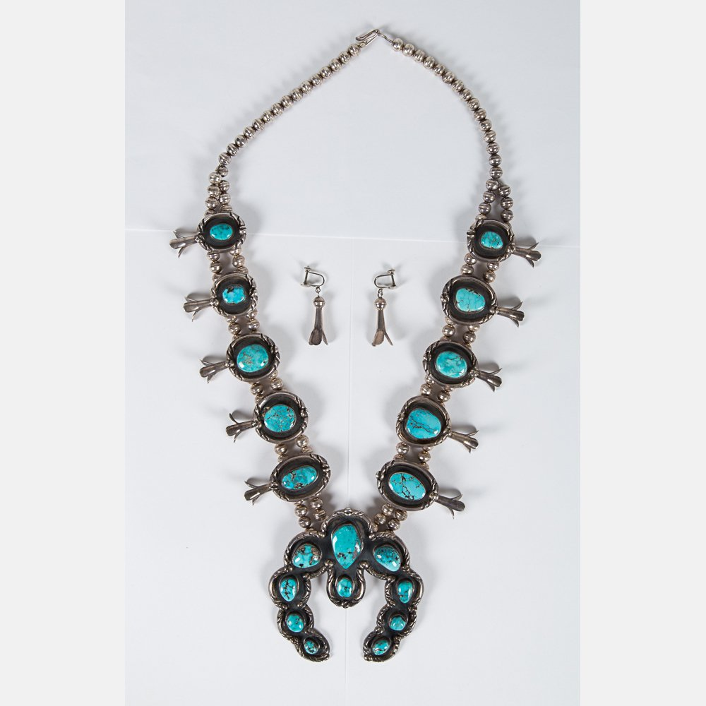 A Navajo Silver and Turquoise Squash Blossom Necklace