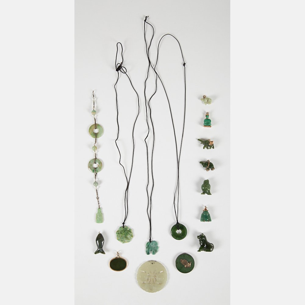 A Miscellaneous Collection of Carved Jade Pendants,