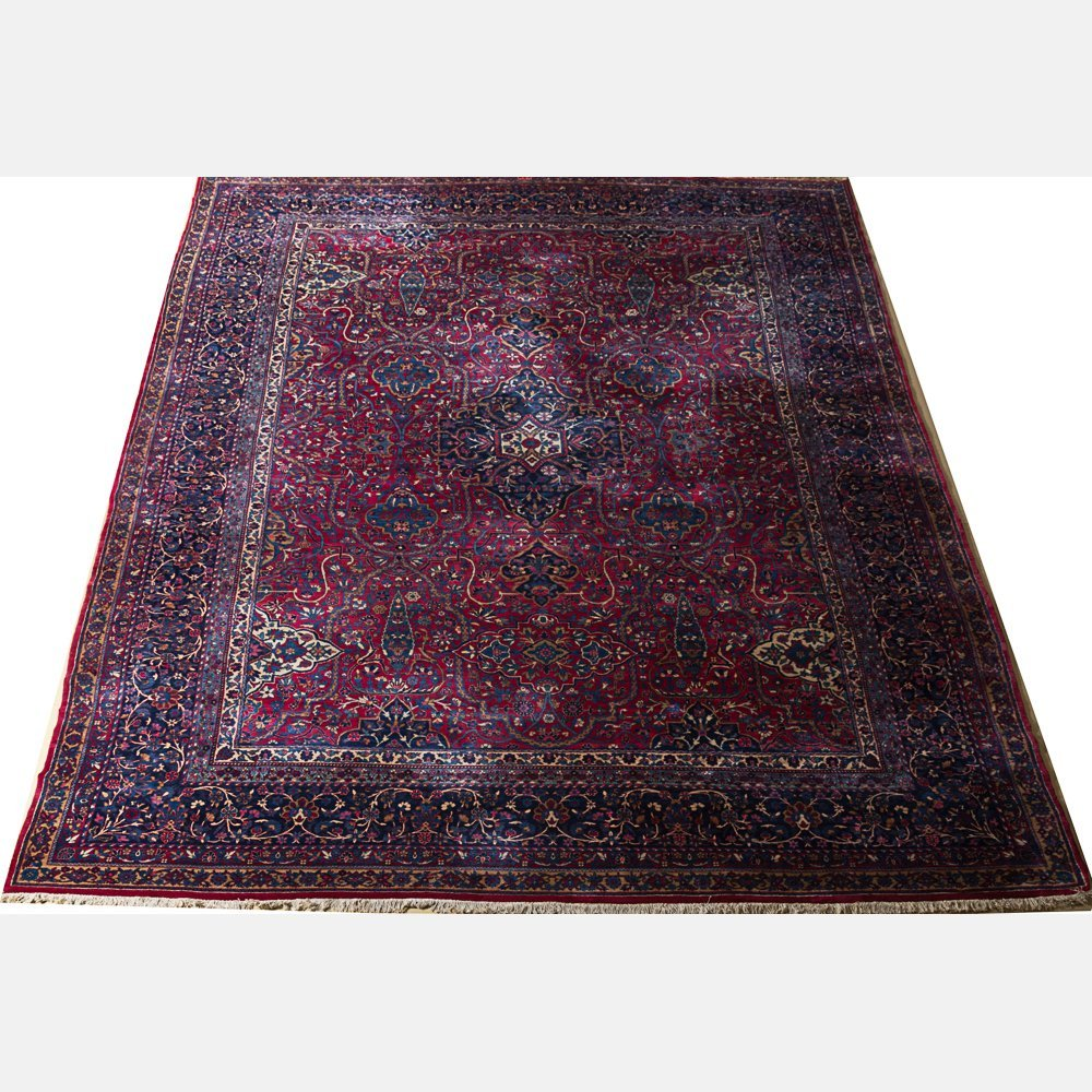 A Kerman Wool Rug, 20th Century.