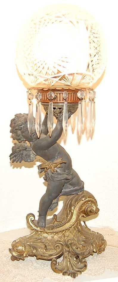 9: WINGED CHERUB LAMP ON DOLPHIN BASE