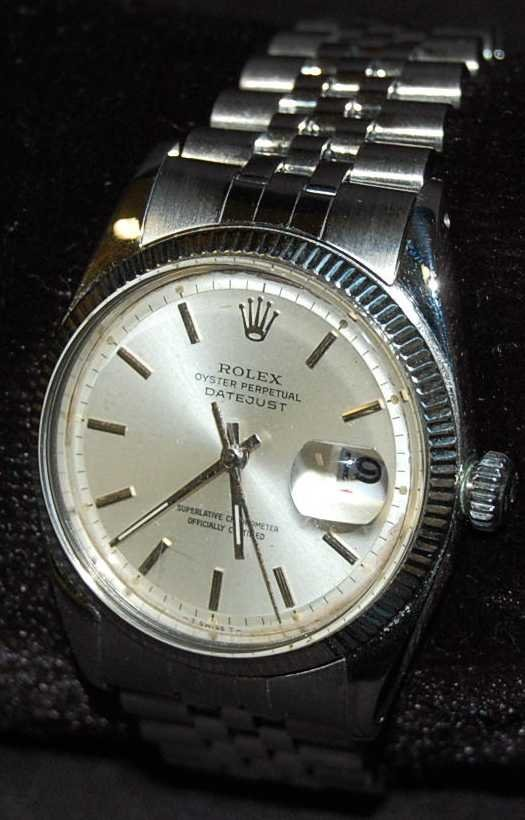 101: MANS STAINLESS STEEL ROLEX WATCH