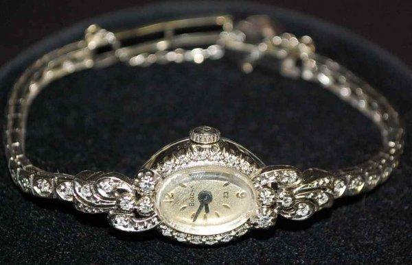 23: Ladies 14K Gold & Diamond Bulova Watch