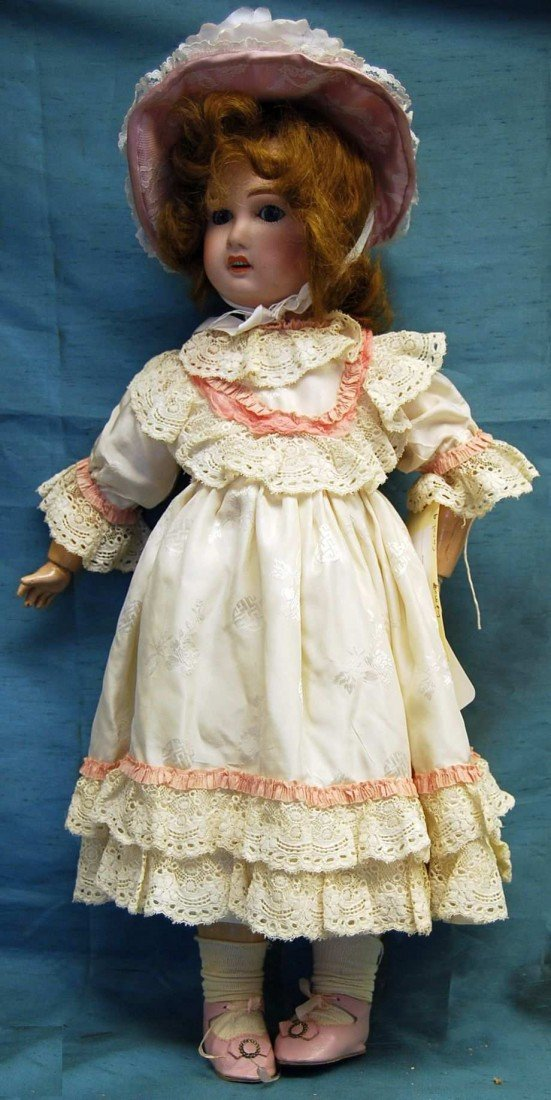 11: FABRIC LIMOGES CAROL DOLL