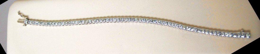 023: FINE 4.5 cttw DIAMOND TENNIS BRACELET IN 14k WHITE