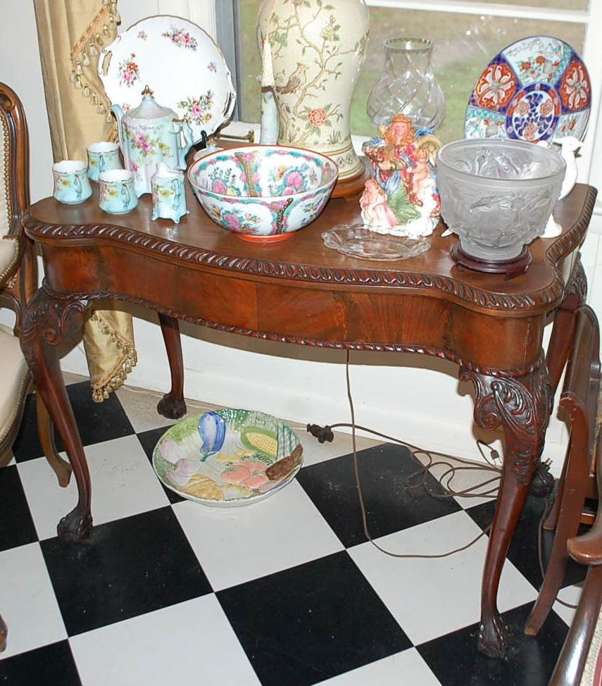 008: CHIPPENDALE MAHOGANY SERPENTINE GAME TABLE