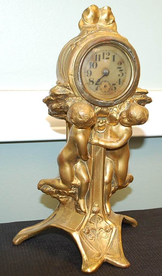 023: ART NOUVEAU GILT CHERUB CLOCK