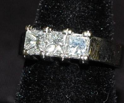 003: 14KT GOLD PAST PRESENT & FUTURE DIAMOND RING
