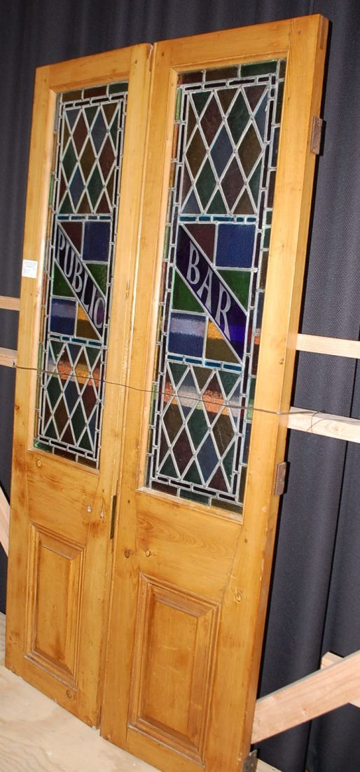 026: PAIR OF LEADED STAIN GLASS BAR DOORS