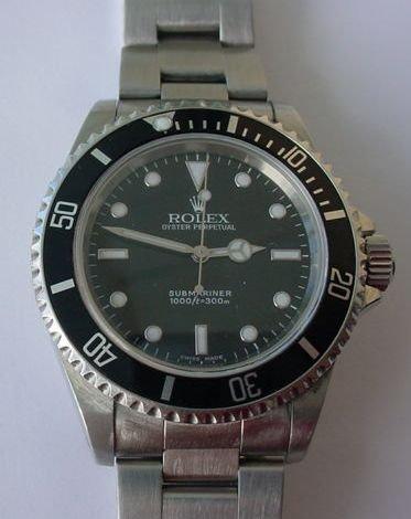 023: ROLEX STAINLESS STEEL SUBMARINER WATCH