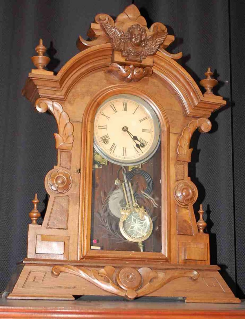 Early walnut Victorian angel crest mantle clock