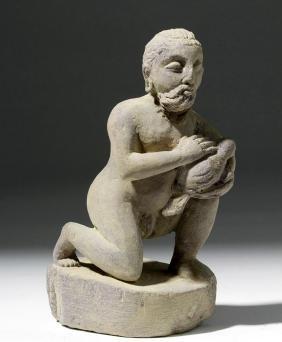 1st C. Gandharan Schist Dana Figure Holding Bird