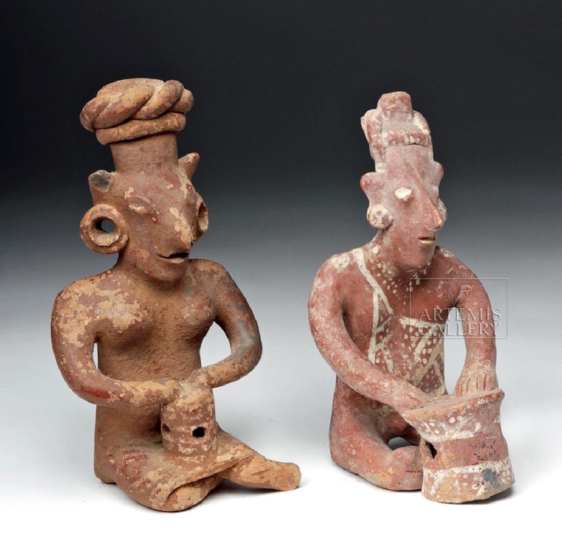 Pair of Jalisco Seated Ceramic Sheepface Female Figures