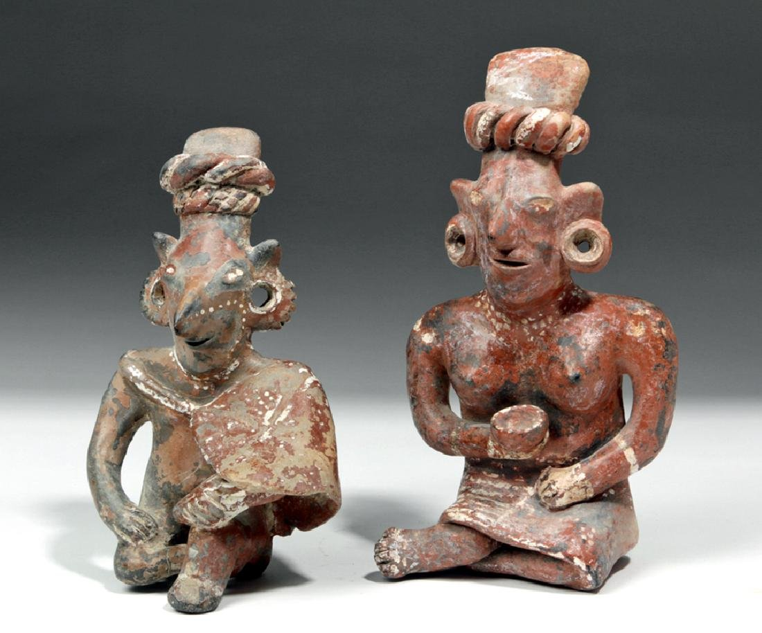 Pair of Fine Jalisco Pottery Sheepface Seated Figures