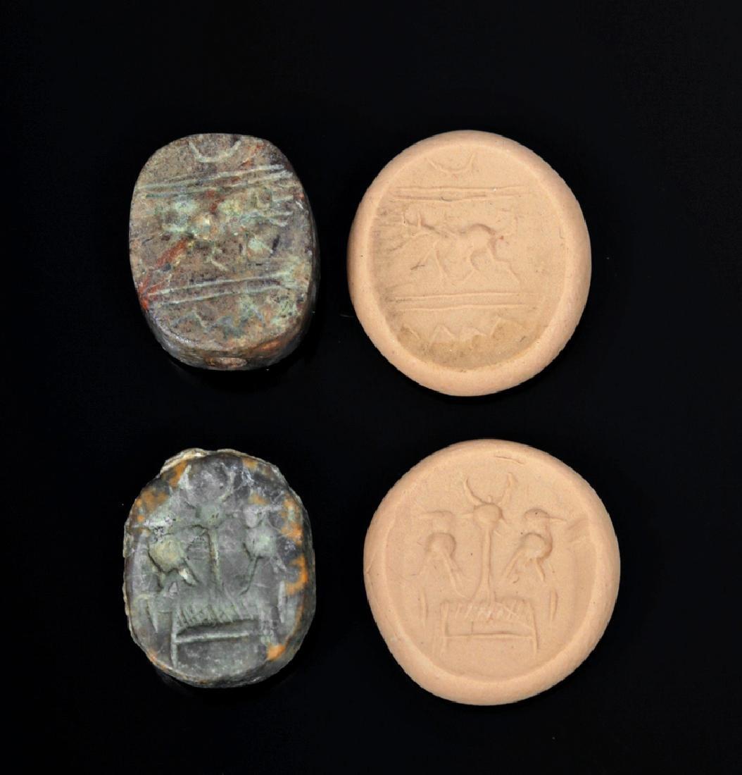 Pair of Near-Eastern Terracotta Scaraboid Seals