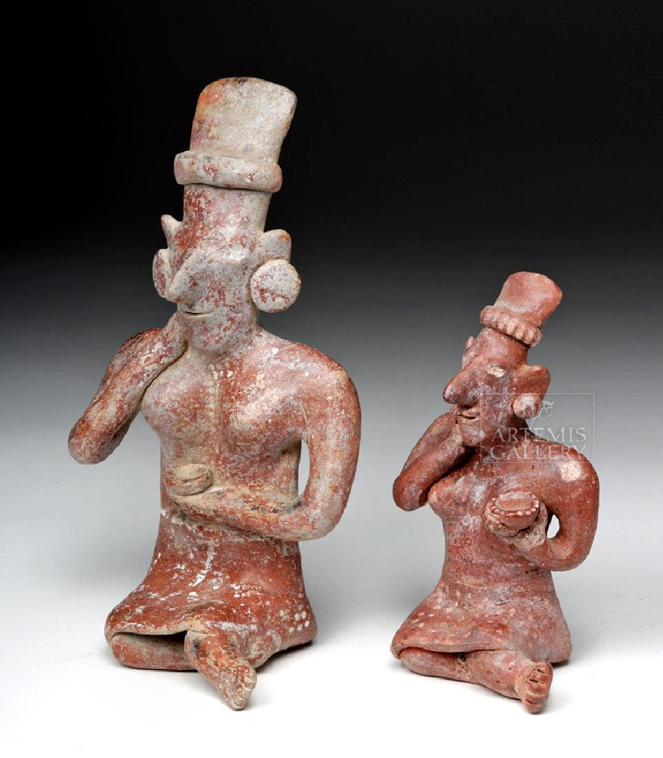 Pair of Jalisco Pottery Sheepface Seated Female Figures