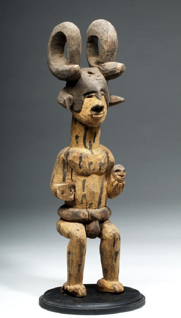 African Wood Figure of Man Wearing Antelope Horns