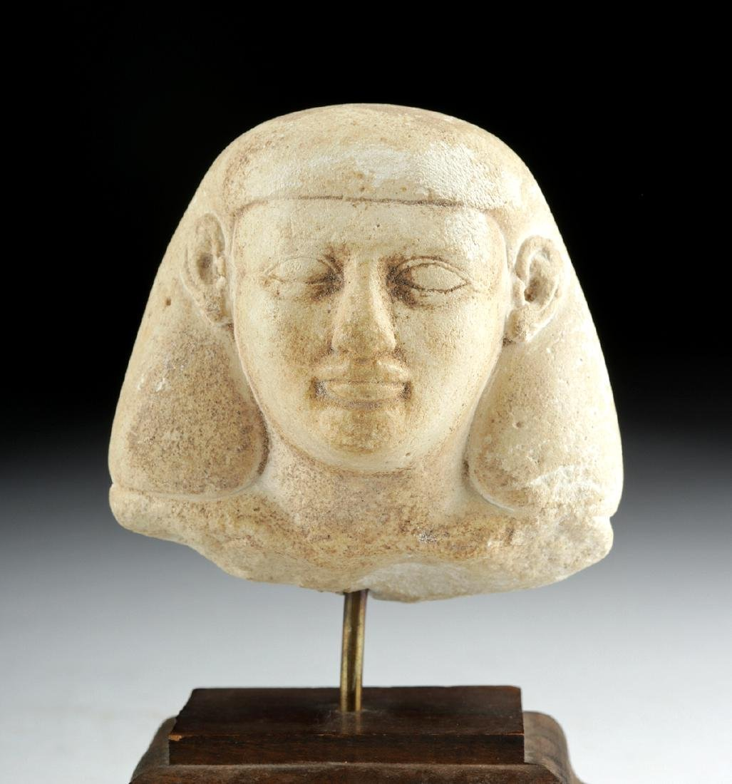 Egyptian Limestone Sculptor's Model Head of an Official