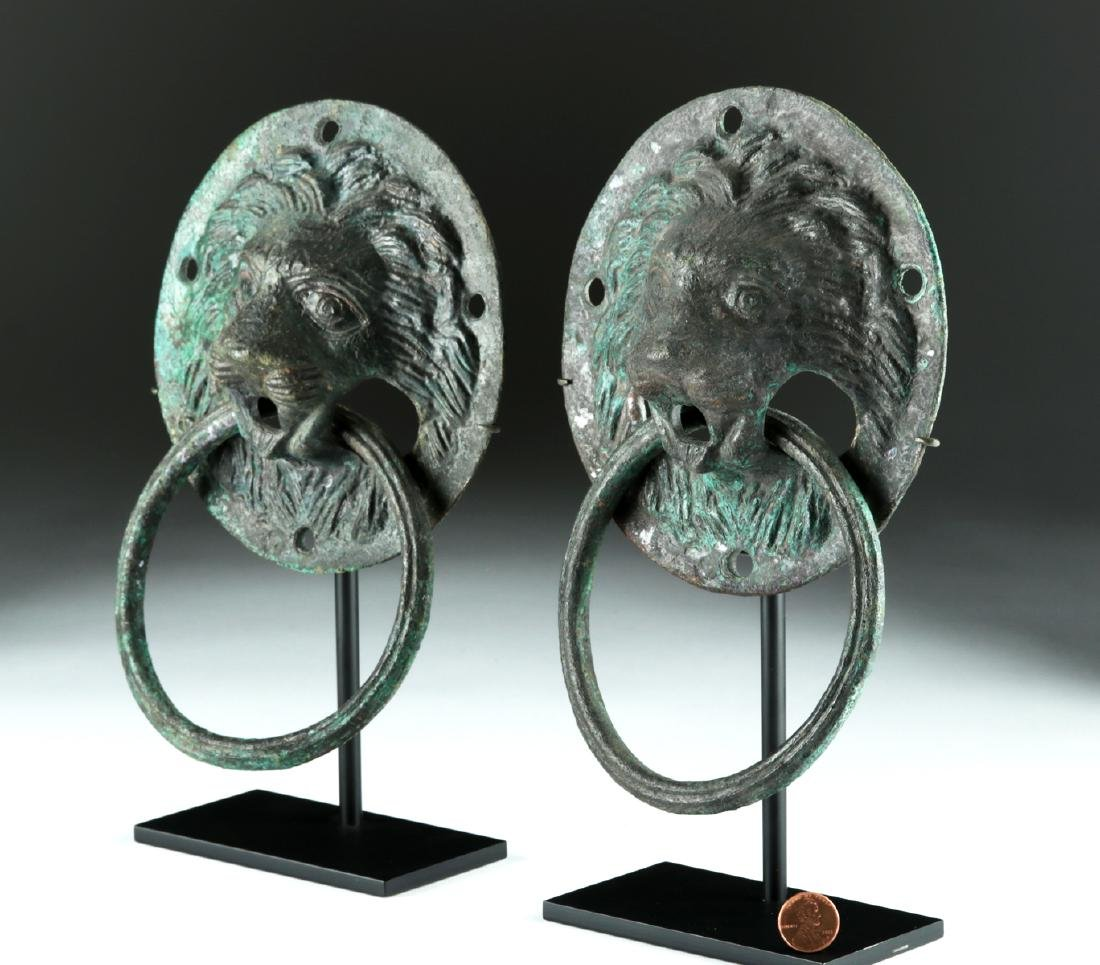 Matched Pair of Roman Copper Lion-Headed Handles