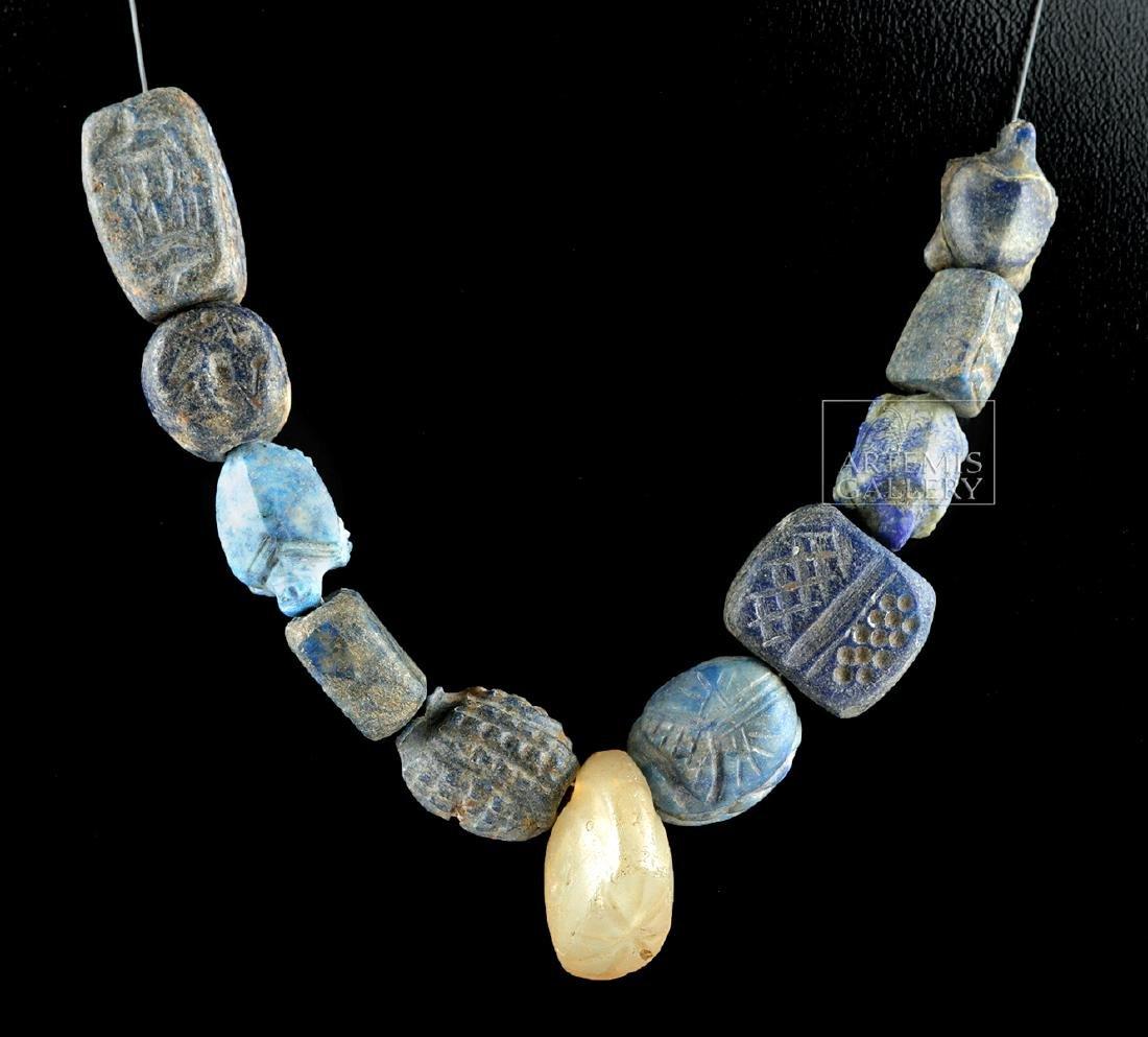 Lot of 11 Bactrian Lapis Lazuli & Rock Crystal Beads