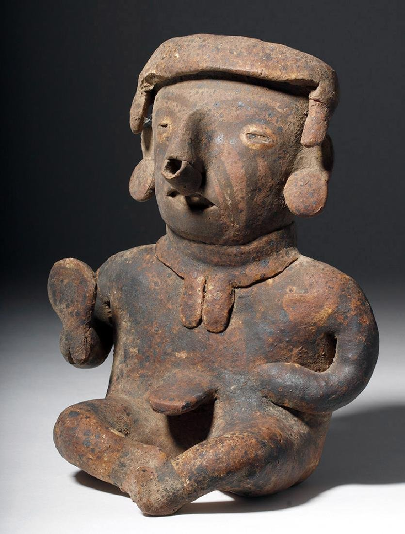 Nayarit Pottery Seated Male with Rattle