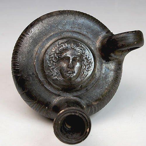 34: Greek Black-Glaze Guttos with Medusa