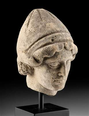 Greek Terracotta Head of a Youth Wearing Pilos Helmet