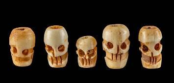 Five 20th C. Tibetan Carved Bone Skull Beads