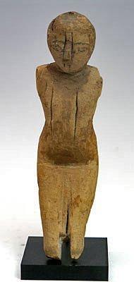 55: An Egyptian Wooden Boatman, Middle Kingdom