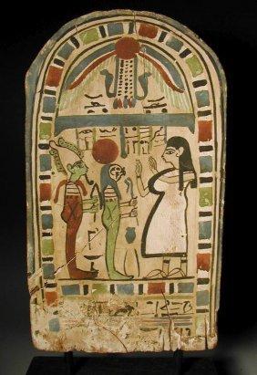 An Egyptian Wood Stele, Polychrome Decoration